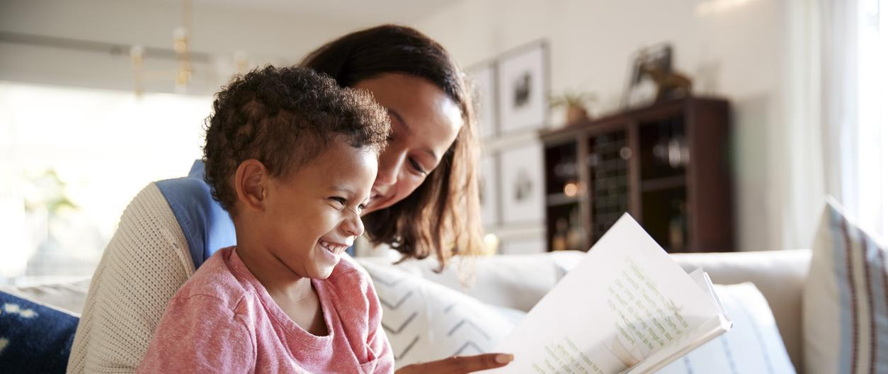 Mother reads book to child